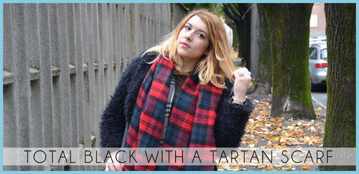 total black with a tartan scarf